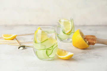 Fotobehang - Glasses of healthy infused water on table