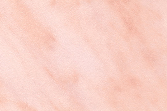 Texture of light pink marble with white lines of a pattern, macro background. Pastel rose color stone backdrop.