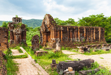 Wall Murals Deep brown Remains of Hindu tower-temples at My Son Sanctuary, a UNESCO World Heritage site in Vietnam.