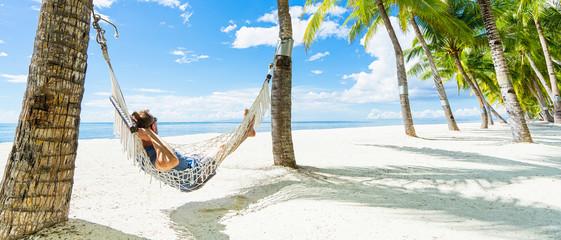 Man in hammock on the beautiful tropical beach. Banner. Fototapete