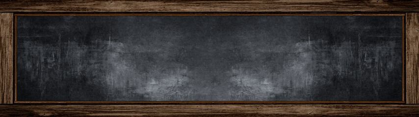 Empty blank old anthracite blackboard with wooden frame and space for text - School background, banner Panorama long