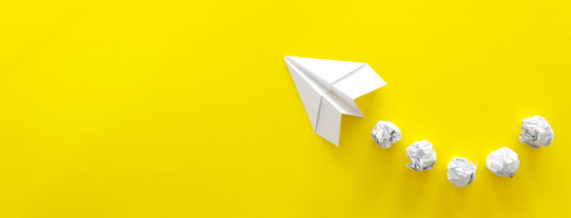 education or innovation concept. paper origami plane over yellow background