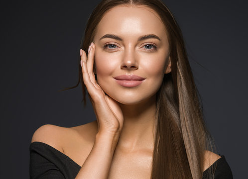 Female face beauty woman long hair fly natural make up clean healthy skin hand touching face