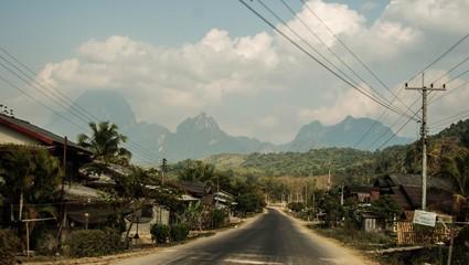 Foto auf Acrylglas Rosa dunkel Empty Road Along Countryside Landscape