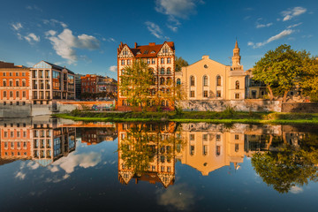 Foto auf Gartenposter Stadt am Wasser Spring view of city Opole in Silesia in Poland. Historical old town in gold light.