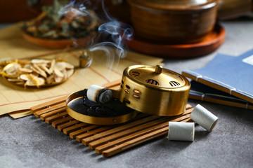 Chinese copper moxibustion box with smoke on bamboo
