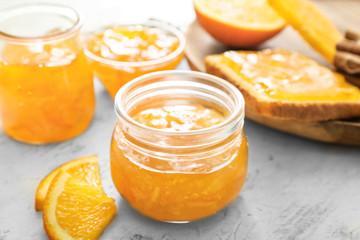 Fotobehang - Jar of orange jam on table