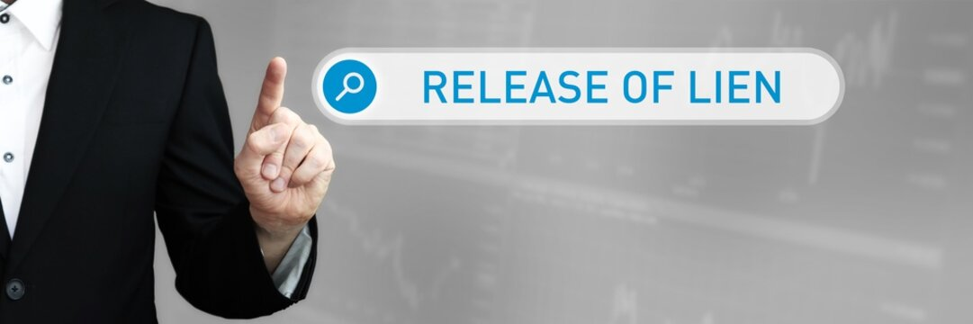 Release of Lien. Man in a suit points a finger at a search box. The word Release of Lien is in the search. Symbol for business, finance, statistics, analysis, economy