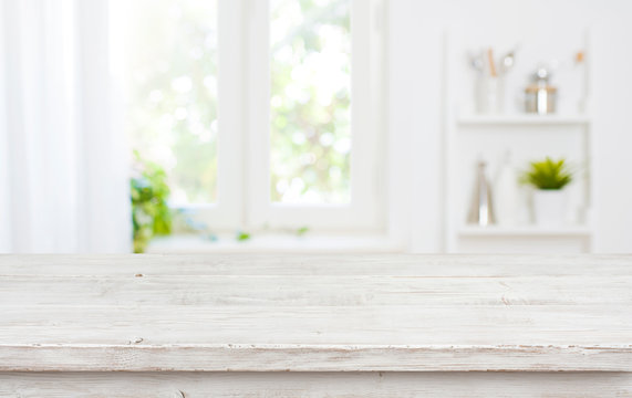 Free space table top background on blurred kitchen window interior
