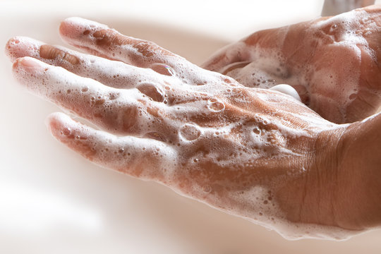 Thoroughly washing hands with soap