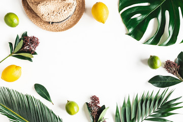 Summer composition. Tropical leaves, hat, fruits on white background. Summer concept. Flat lay, top view, copy space
