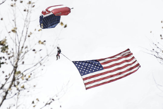 Low Angle View Of Person With American Flag Paragliding Against Clear Sky