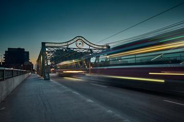 Light Trails On Bridge In City Against Sky