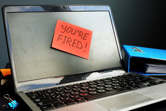 You are fired sign on the workplace. Wrongful Termination concept.