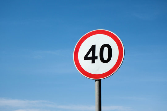 International traffic sign 'Speed limit' (to 40 km per hour). Blue sky is on  background