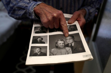 Petr Brandejsky, a 90-year-old Holocaust survivor, points at a picture at his apartment in Prague