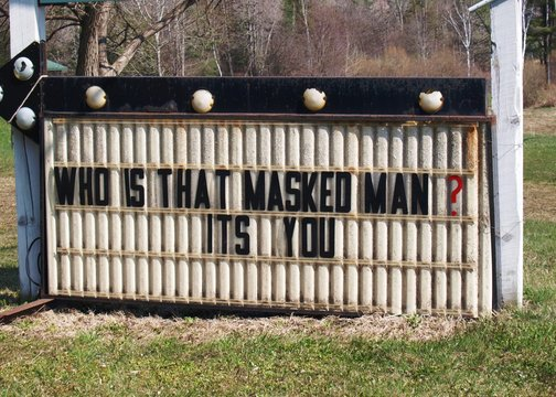 A humorous sign during the American Covid-19 outbreak asks Who Is That Masked Man in a reference to the classic Lone Ranger show and with the current need to wear a mask as protection answers It's You