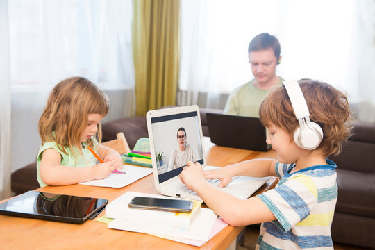 Two kids learn at home online. work from home with kids. quarantin. Home office. homeschooling, distant learning