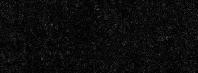 Black background of a texture of cement wall, little stone and concrete - Dark stage background - Large panoramic format Fototapete