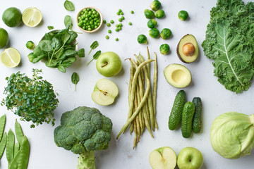 Pattern flat lay with healthy vegetarian meal ingredients. Raw food concept. A variety of organic fruits and vegetables with avocado. Vegan menu.