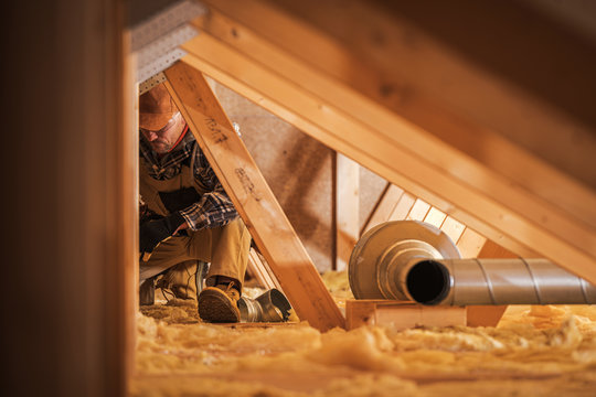 Air Ventilation Installer Working in Attic