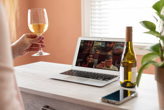 Woman enjoying a virtual happy hour with family during social distancing