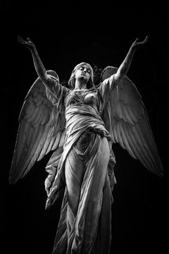 Low Angle View Of Statue Against Black Background