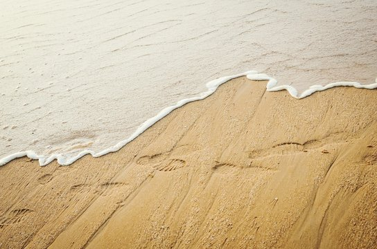 High Angle View Of Shoeprints On Beach