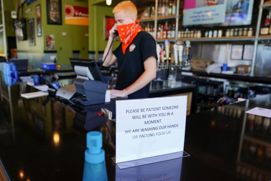 A sign referencing hand washing is seen at Bad Daddy's Burger Bar on the day restaurants and theaters were allowed to reopen to the public as part of the phased reopening of businesses from  the coronavirus disease rules in Smyrna