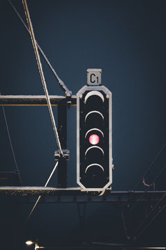Low Angle View Of Illuminated Red Light Signal Against Sky During Winter