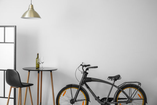 Interior of modern room with chair, table and bicycle