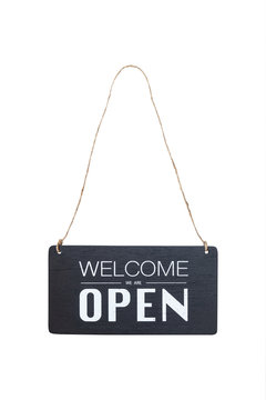 welcome we are open sign board hanging on a rope