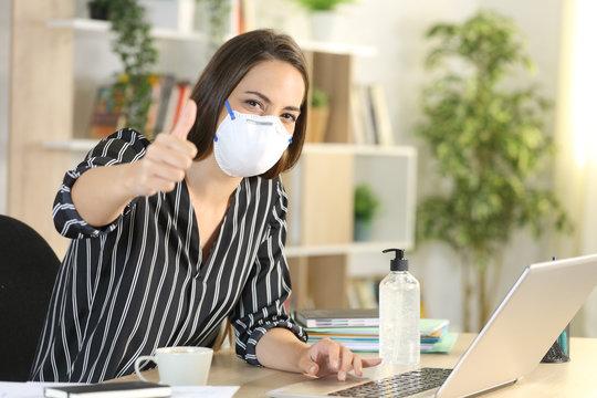 Woman with thumbs up teleworking in coronavirus quarantine