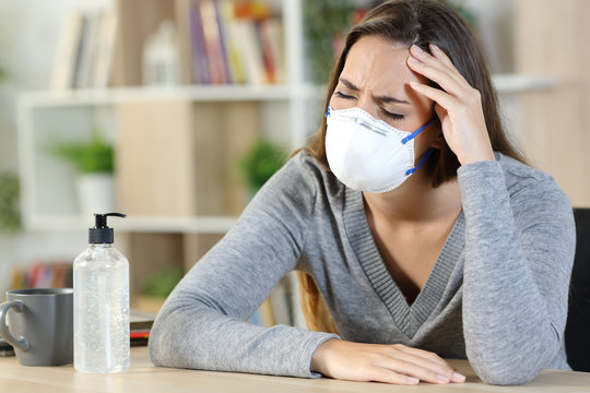 Sick woman suffering covid-19 symptoms at home