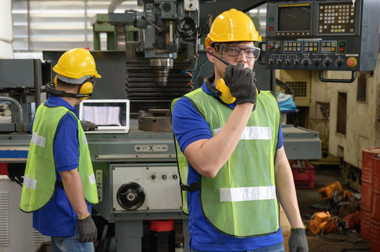 Asian male inspector, engineer commanding by walkie-talkie in the production line process in factory