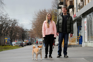 A newly married couple, Helios and Luiza, walk their dog amid the outbreak of the coronavirus disease in Saint Petersburg