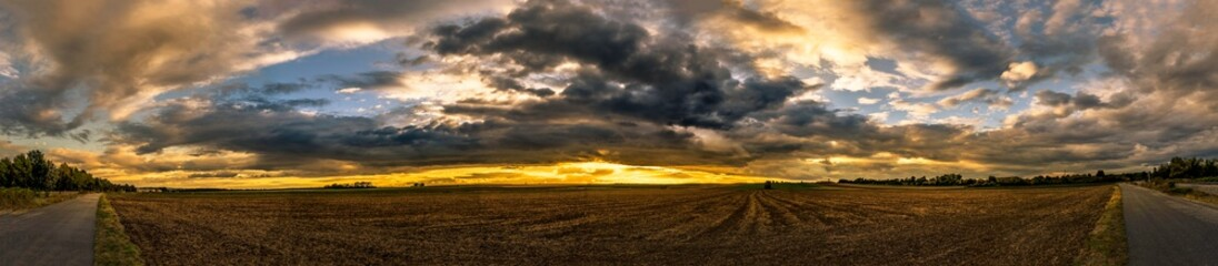 Foto auf AluDibond Schokobraun Panoramic Shot Of Countryside Landscape Against Cloudy Sky