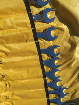 Close-up Of Wrenches In Yellow Canvas Pouch