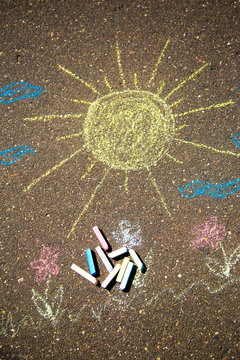 sun is drawn in chalk on the pavement