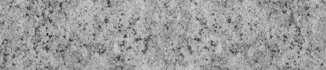 Granite rock texture background close up view. Grey granite mineral stone, simple black and white surface. Natural granite material background, abstract empty seamless rock texture backdrop