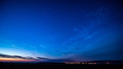 Foto auf AluDibond Dunkelblau Scenic View Of Landscape Against Blue Sky At Night