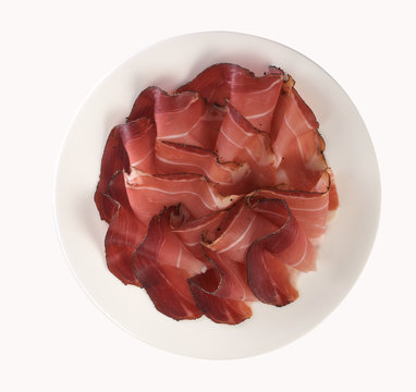 Speck ham sliced and served, isolated on white background, top view