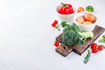 Keuken foto achterwand Keuken Healthy vegetables broccoli, tomato and bell pepper and eggs