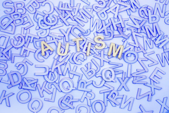 Chaotic Autism Alphabet Concept  Background - Blue A to Z letters scattered randomly across background with the word AUTISM picked out in the centre