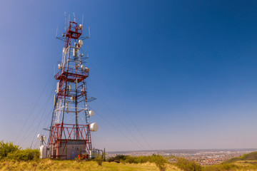 telecommunications tower with antennas on the hill