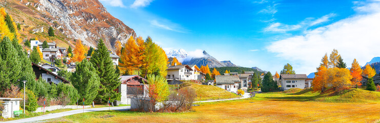 Awesome autumn scene in Maloja village on the shore of Sils lake(Silsersee)