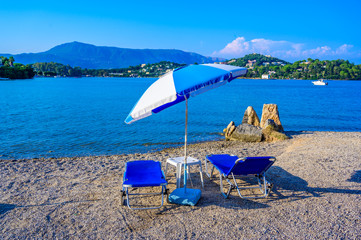 Wall Mural - Gouvia beach is close to Kerkyra is a paradise beach with crystal clear azure water in Corfu, Ionian island, Greece, Europe
