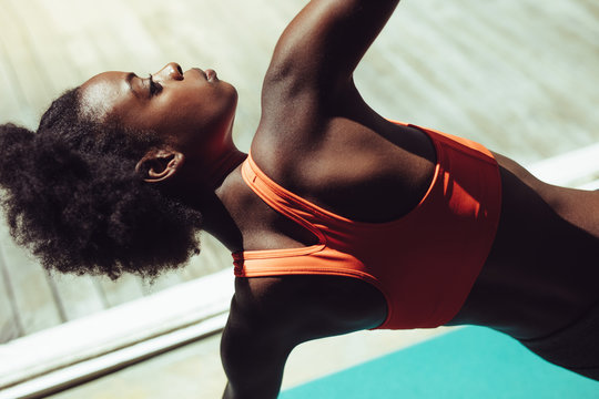 Fitness woman doing yoga stretches