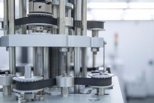 Block of servo motors belts on an electronic equipment factory.