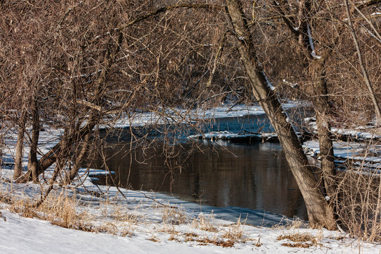 East branch of the Rock River flows through Mayville, Wisconsin  following a recent February snowfall.